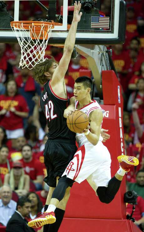 Jeremy Lin, passing after being confronted by Blazers center Robin Lopez, was more aggressive Wednesday. Photo: Brett Coomer, Staff / © 2014 Houston Chronicle