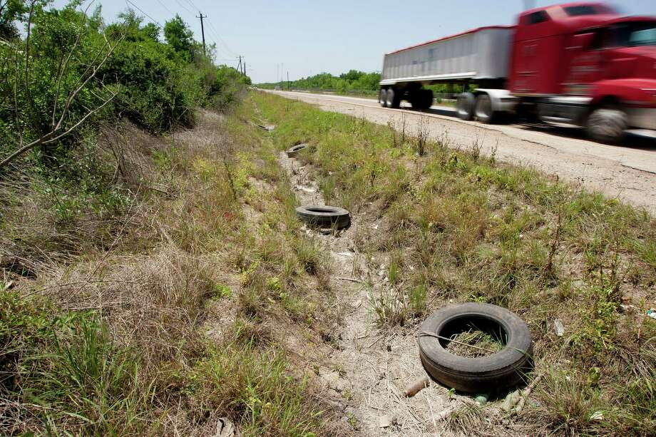 This stretch of Holmes Road lies inside Houston's city limits but has long been ignored by developers due to its lack of infrastructure. Its 1,400 acres are the city's largest single mass of undeveloped land. Photo: Johnny Hanson / © 2014  Houston Chronicle