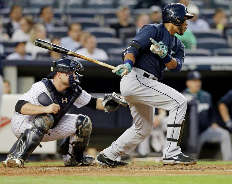 Seattle Mariners' Robinson Cano follows through on an RBI single during the third inning of a baseball game against the New York Yankees, Thursday, May 1, 2014, in New York. (AP Photo) ORG XMIT: NYY112 Photo: Frank Franklin II / AP
