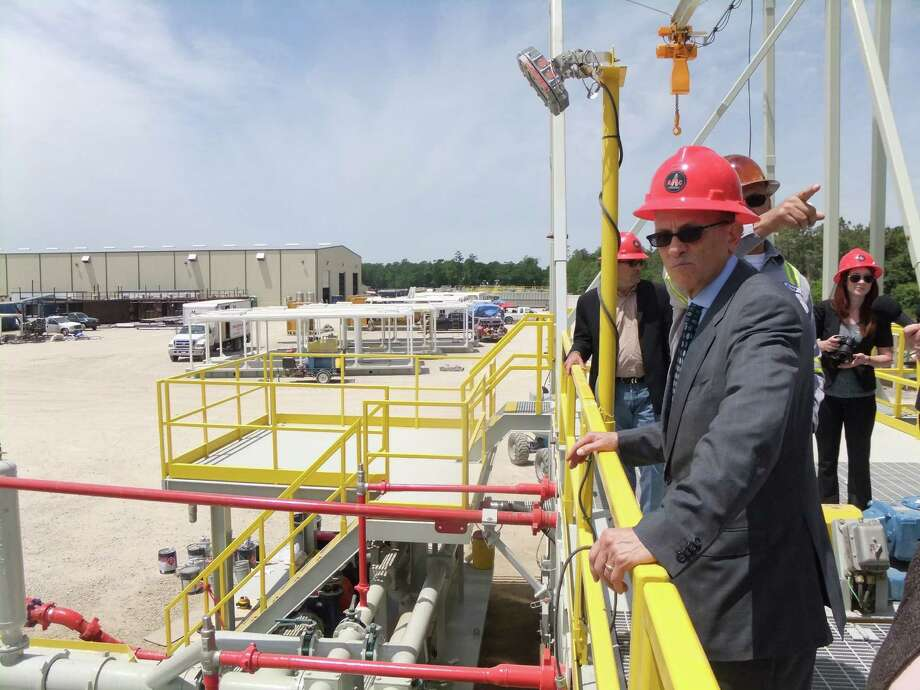 Joe Schelebo, a project manager for Nabors Industries, points as Fred Hochberg, foreground, chairman and president of the Export-Import Bank of the United States, tours a Conroe facility where Applied Machinery Corp.builds and refurbishes onshore drilling rigs for Nabors. Applied Machinery obtains some of its financing and insurance through the bank. (Ryan Holeywell/Houston Chronicle) Photo: Ryan Holeywell