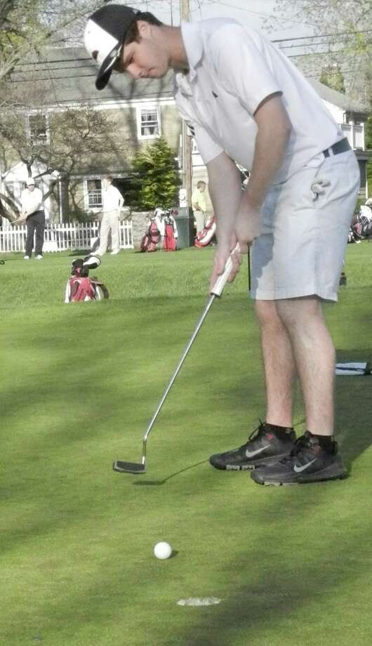 Fairfield Warde junior Daniel Levy putts on the ninth green on Thursday, May 1 at Brooklawn Country Club in Fairfield. The Mustangs competed against Fairfield Prep, Greenwich and Hamden in boys golf and went 1-2 on the day. Photo: Reid L. Walmark / Fairfield Citizen
