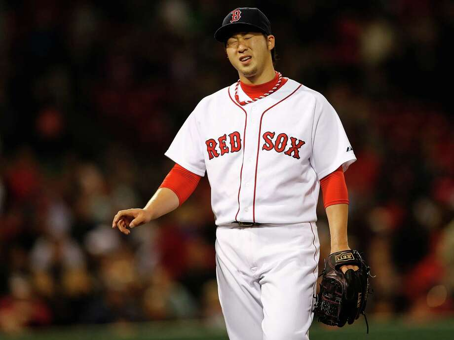 BOSTON, MA - MAY 1: Junichi Tazawa #36 of the Boston Red Sox reacts after giving up a run in the eighth inning against the Tampa Bay Rays in game two of a doubleheader at Fenway Park May 1, 2014  in Boston, Massachusetts. (Photo by Jim Rogash/Getty Images) ORG XMIT: 477582705 Photo: Jim Rogash / 2014 Getty Images
