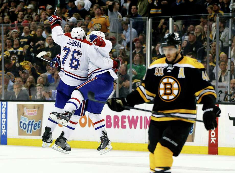 Montreal Canadiens defenseman Francis Bouillon jumps with defenseman P.K. Subban (76) to celebrate his goal as Boston Bruins center David Krejci, right, skates away during the third period in Game 1 of an NHL hockey second-round playoff series in Boston, Thursday, May 1, 2014. (AP Photo/Elise Amendola) ORG XMIT: MAEA126 Photo: Elise Amendola / AP