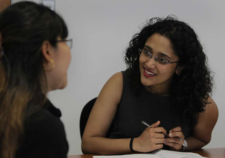 Gitanjali Rawat (right) coaches Tipawan Kerareenuntawaut, an immigrant from Thailand, on her job-searching strategy at S.F.'s Upwardly Global. Photo: Paul Chinn, The Chronicle