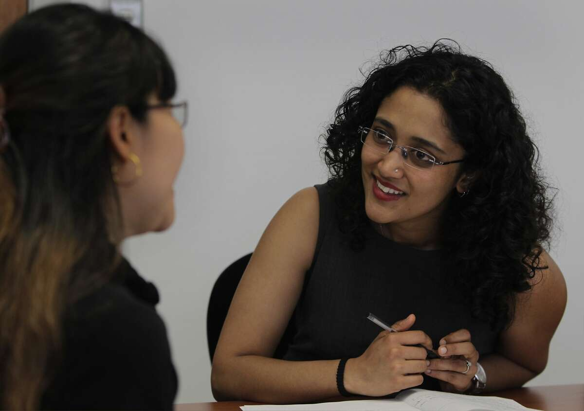 Gitanjali Rawat (right) coaches Tipawan Kerareenuntawaut, a finance management professional from Thailand, with job searching strategy at the offices of Upwardly Global in San Francisco, Calif. on Thursday, May 1, 2014. Rawat, is also a recent gradaute of the Upwardly Global program.