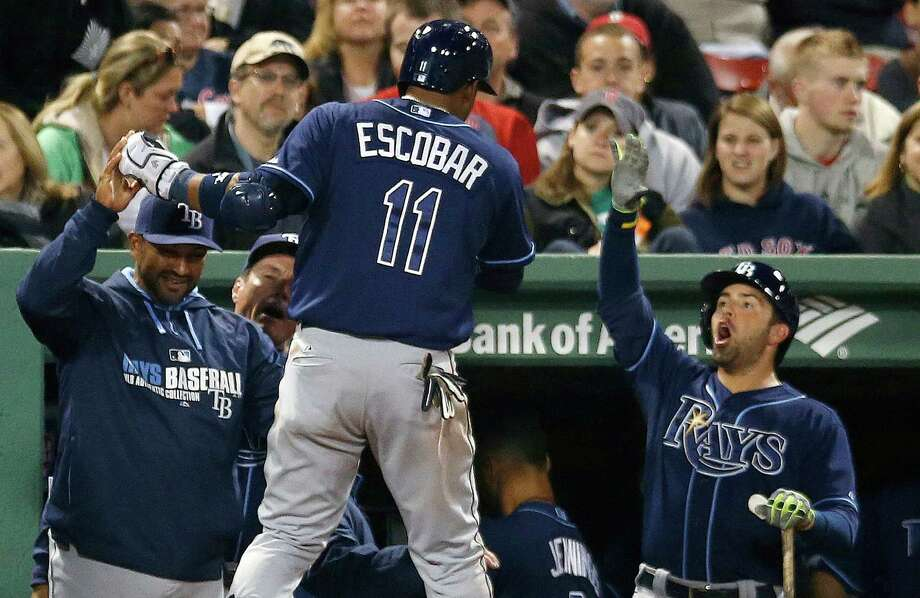Yunel Escobar makes the Rays' long day at Fenway Park especially enjoyable with a ninth-inning homer that broke a 5-5 tie in the nightcap of a doubleheader. Photo: Michael Dwyer, STF / AP