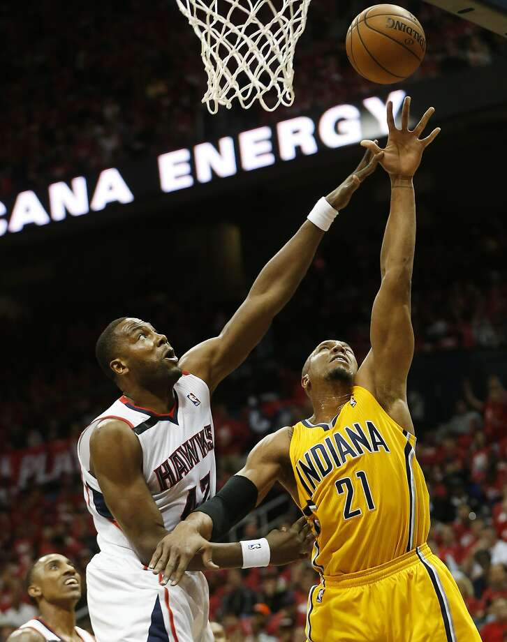 David West, evading Atlanta's Elton Brand for a first-quarter shot, finished with 24 points, 11 rebounds and six assists. Photo: John Bazemore, Associated Press