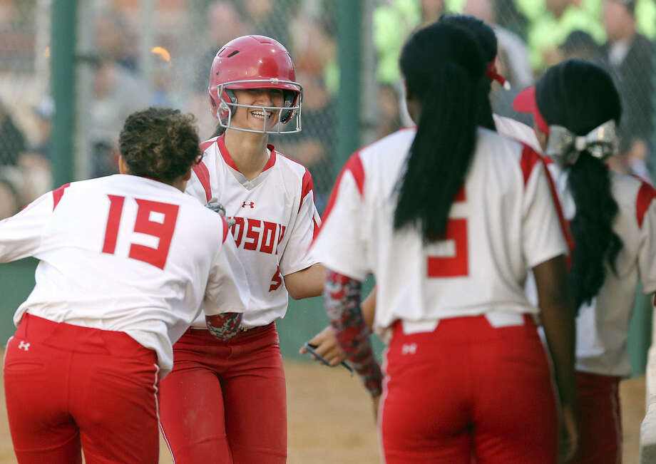 Judson's Arianna Ricondo (center) is congratulated by teammates after scoring a run in the third inning of Game 1 of their second-round playoff series against Southwest. Judson won 8-4. Photo: Edward A. Ornelas / San Antonio Express-News / © 2014 San Antonio Express-News