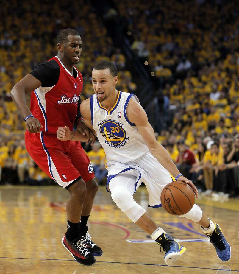 Stephen Curry (30) drives against Chris Paul (3) in the first half. The Golden State Warriors played the Los Angeles Clippers at Oracle Arena in Oakland, Calif., on Thursday, May 1, 2014, in Game 6 of the NBA first round playoffs. Photo: Carlos Avila Gonzalez, The Chronicle