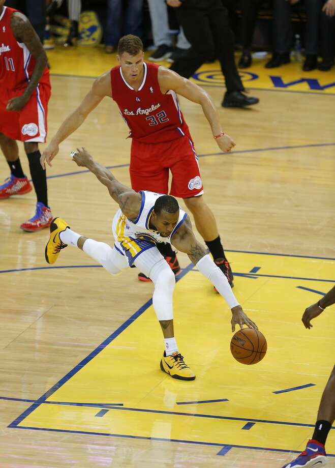 Warriors Andre Iguodala, (9) scrambles to control a loose ball during the second half, as the Golden State Warriors went on to  beat the Los Angeles Clippers 100-99, on Thursday May 1, 2014, in Oakland, Calif., in game 6 of the NBA Western Conference playoffs. Photo: Michael Macor, The Chronicle
