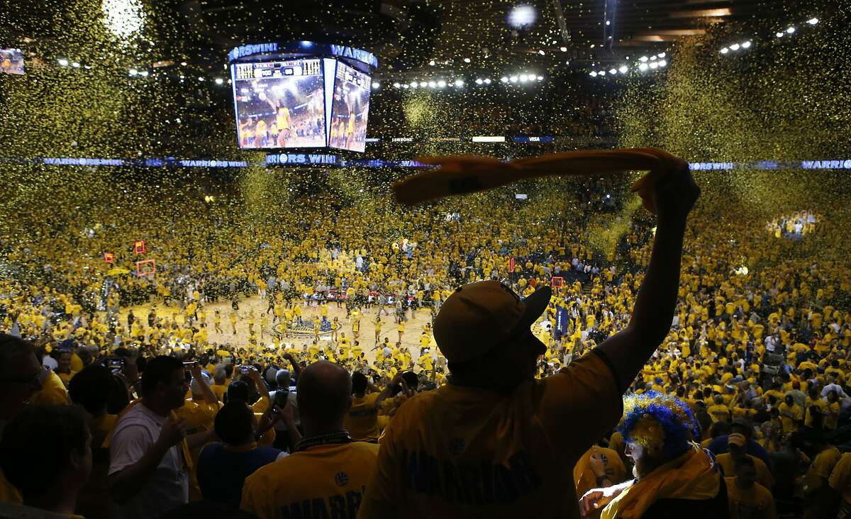 Fans celebrate the victory as the Golden State Warriors beat the Los Angeles Clippers 100-99. on Thursday May 1, 2014, in Oakland, Calif., in game 6 of the NBA Western Conference playoffs.