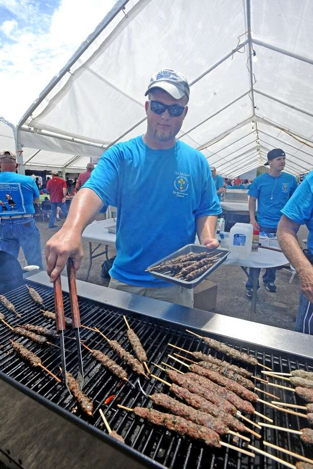 Matthew Eberlan cooks kafta at the St. Michael Orthodox Christian Church Mediterranean Festival on Saturday, May 11, 2013. Photo taken: Randy Edwards/The Enterprise