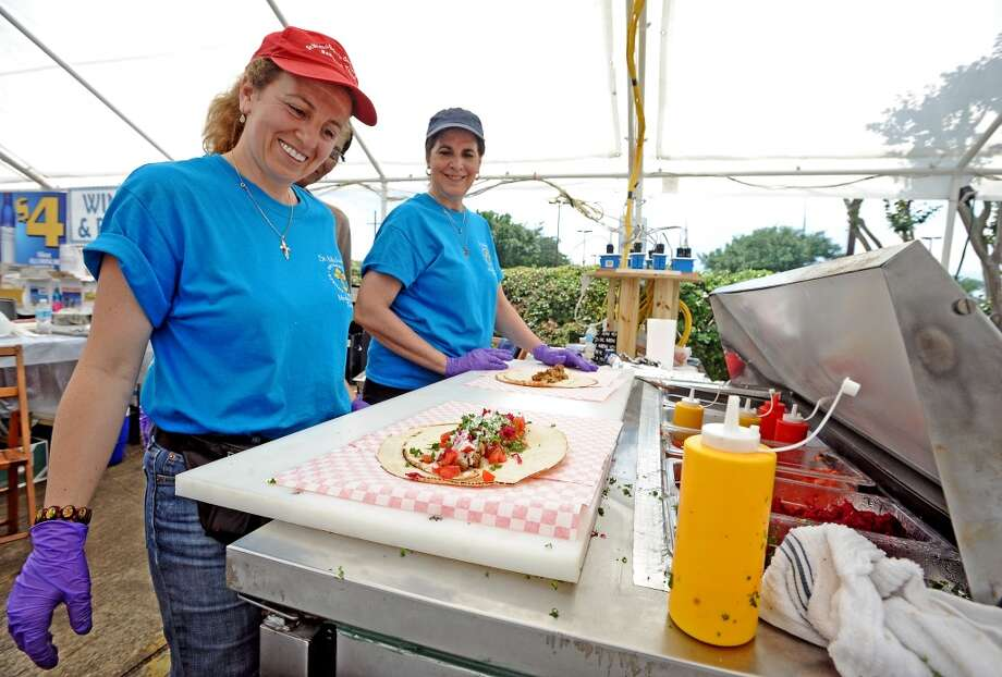 Mireille Pavez fixes up a falafel at the St. Michael Orthodox Christian Church Mediterranean Festival on Saturday, May 11, 2013.