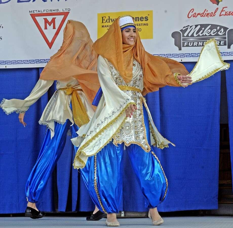 The Al Awtar Zaffa Group participates in folk dancing at the St. Michael Orthodox Christian Church Mediterranean Festival on Saturday, May 11, 2013. Photo taken: Randy Edwards/The Enterprise