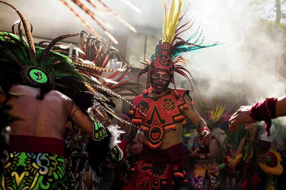 Aztec dancers lead an immigrant rights march heading to downtown Seattle Thursday, May 1, 2014. Photo: JORDAN STEAD, SEATTLEPI.COM / SEATTLEPI.COM