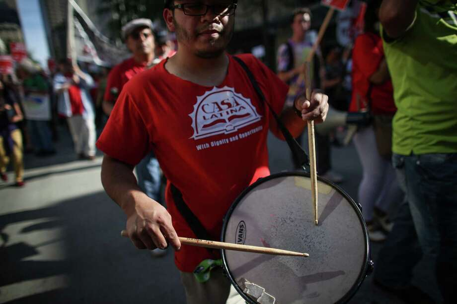 A drum is played during a May Day immigration reform march on Thursday, May 1, 2014. Marchers called for a reform of the US immigration system and for a minimum wage of $15 per hour. Photo: JOSHUA TRUJILLO, SEATTLEPI.COM / SEATTLEPI.COM