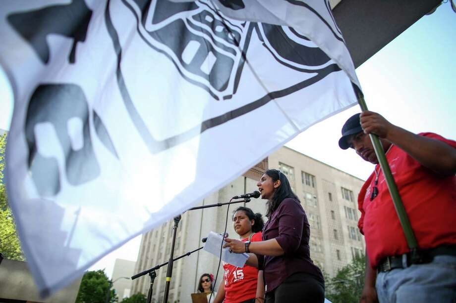 Seattle City Councilmember Kshama Sawant speaks at Westlake Park during a May Day immigration reform march on Thursday, May 1, 2014. Marchers called for a reform of the US immigration system and for a minimum wage of $15 per hour. Photo: JOSHUA TRUJILLO, SEATTLEPI.COM / SEATTLEPI.COM