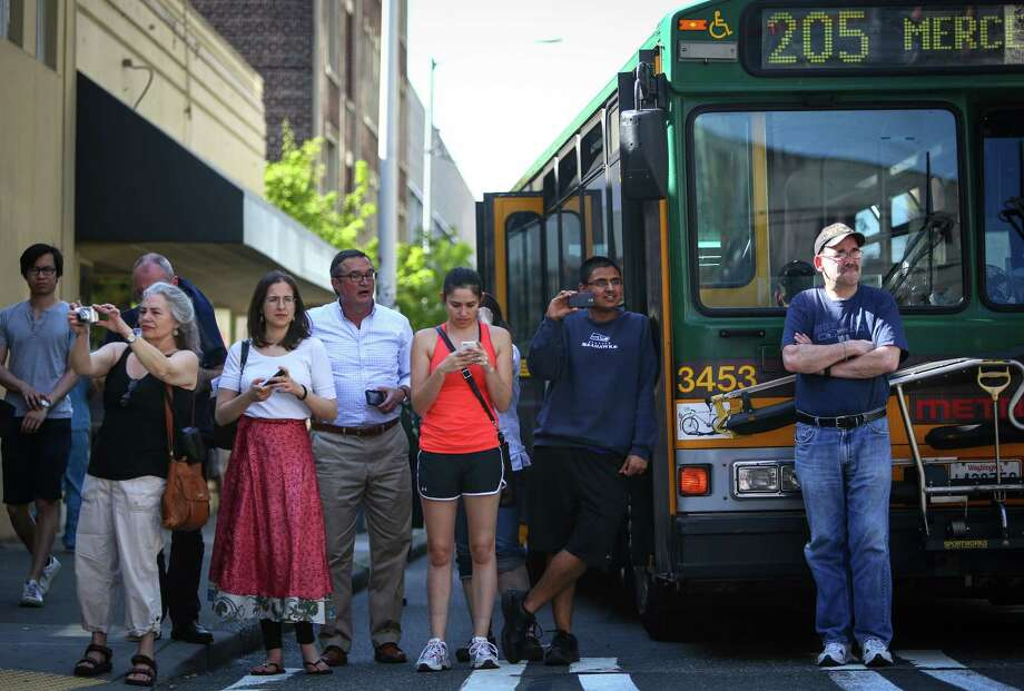 A bus stops to let the march pass during a May Day immigration reform march on Thursday, May 1, 2014. Marchers called for a reform of the US immigration system and for a minimum wage of $15 per hour. Photo: JOSHUA TRUJILLO, SEATTLEPI.COM / SEATTLEPI.COM