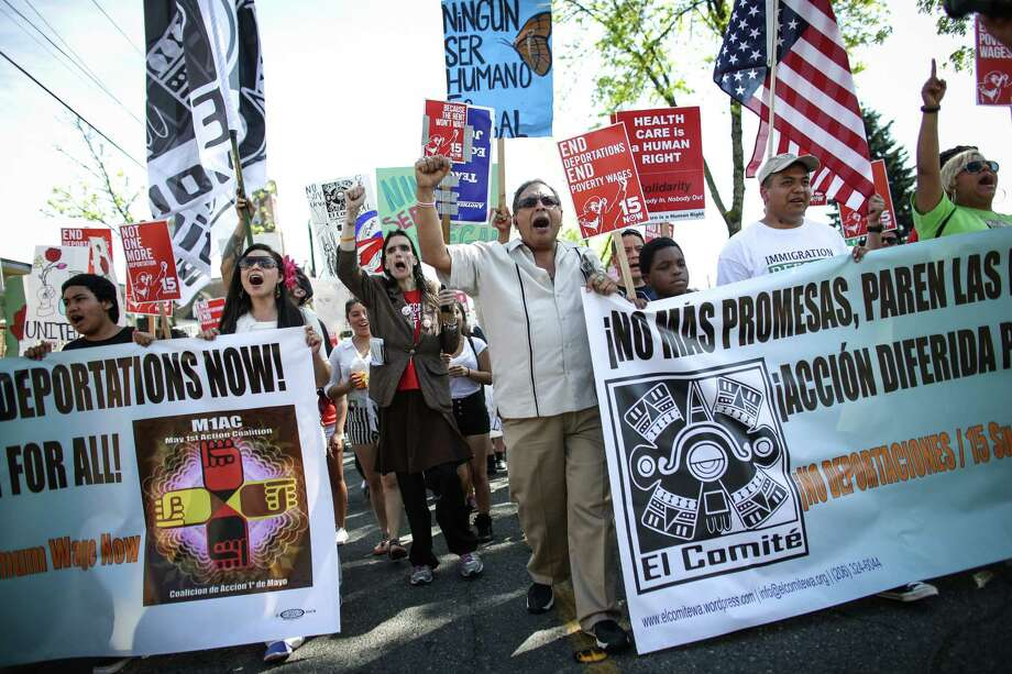 People march during a May Day immigration reform march on Thursday, May 1, 2014. Marchers called for a reform of the US immigration system and for a minimum wage of $15 per hour. Photo: JOSHUA TRUJILLO, SEATTLEPI.COM / SEATTLEPI.COM