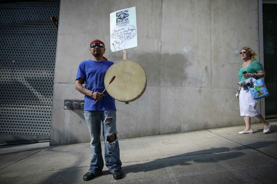 A man plays a drum during a May Day immigration reform march on Thursday, May 1, 2014. Marchers called for a reform of the US immigration system and for a minimum wage of $15 per hour. Photo: JOSHUA TRUJILLO, SEATTLEPI.COM / SEATTLEPI.COM