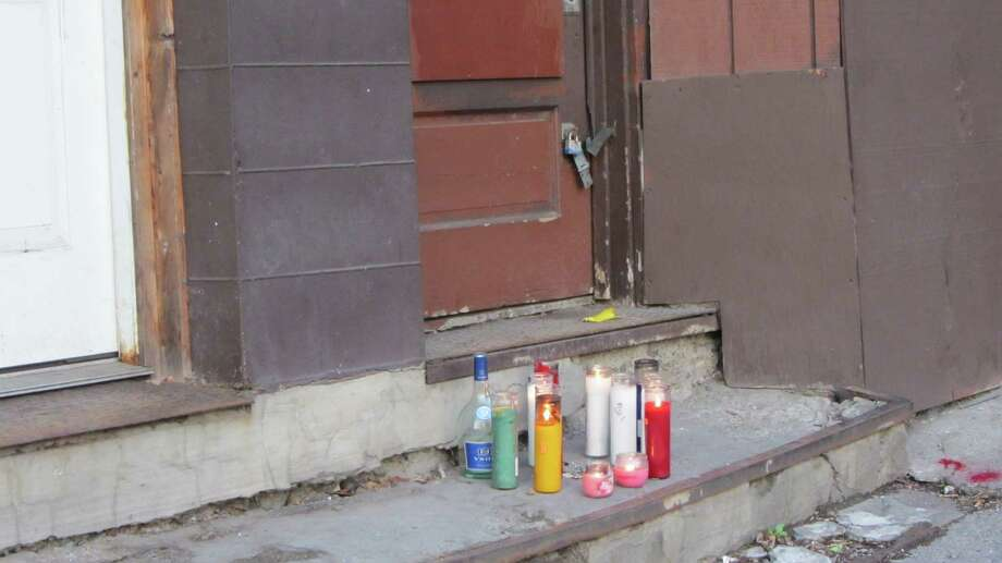 Candles mark the place where a 35-year-old man was found shot Thursday evening on Second Avenue in Albany's South End. (Bob Gardinier / Times Union)