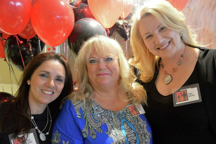 CLASP President Tracy Flood, center, celebrating her 30th year with the agency, joined by A Taste of Westport event co-chairwomen Fides Ostbye, left, and Tracy Mitchell. Photo: Jarret Liotta / Westport News