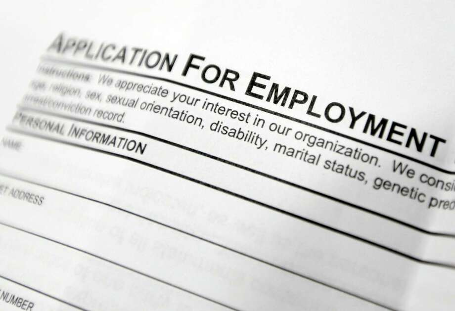 This April 22, 2014 photo shows an employment application form sits on a table during a job fair at Columbia-Greene Community College in Hudson, N.Y. The Labor Department releases employment data for April on Friday, May 2, 2014. Photo: Mike Groll, AP / AP