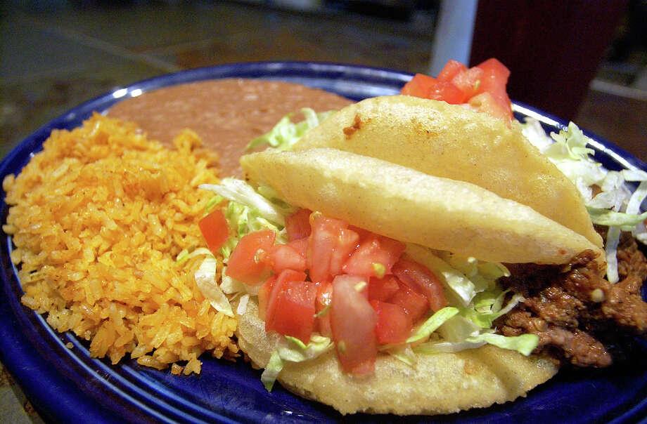 Best Puffy Tacos, Henry's Puffy Tacos. HELEN L. MONTOYA/STAFF Photo: HELEN L. MONTOYA, SAN ANTONIO EXPRESS-NEWS / San Antonio Express-News