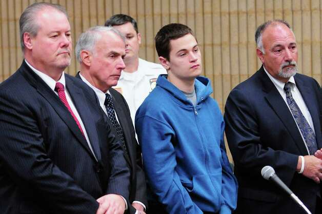 Christopher Plaskon, 16, second from right, stands with defense attorneys Edward Gavin, left, and Richard T Meehan, Jr., far right, and appointed guardian and uncle Paul Healy, second from left, during his public court appearance at Superior Court Friday, May 2, 2014, in Milford, Conn. He is charged in the fatal stabbing of Maren Sanchez, 16, who was stabbed to death April 25 inside a hallway at Jonathan Law High School in Milford. Photo: Peter Hvizdak, Pool / ©PETER HVIZDAK /  NEW HAVEN REGISTER2014