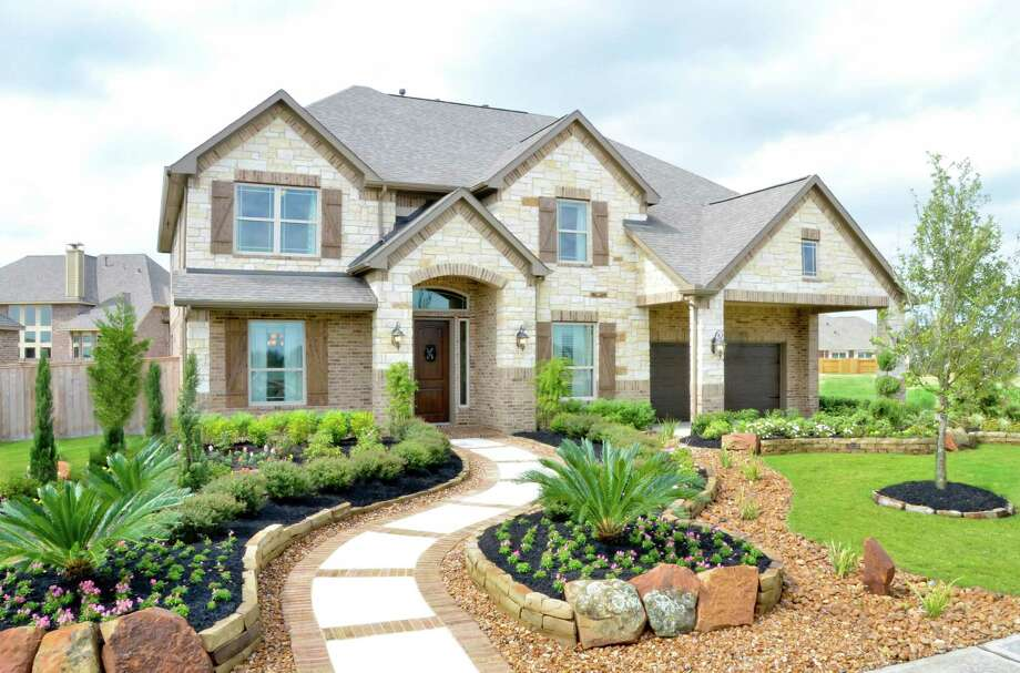 Cinco Ranch builders, including Village Builders (shown) and Perry Homes, have incentives on quick move-in homes priced from the $370,000s in the Bandera Glen neighborhood. / 2011 FrenchBlue Photography