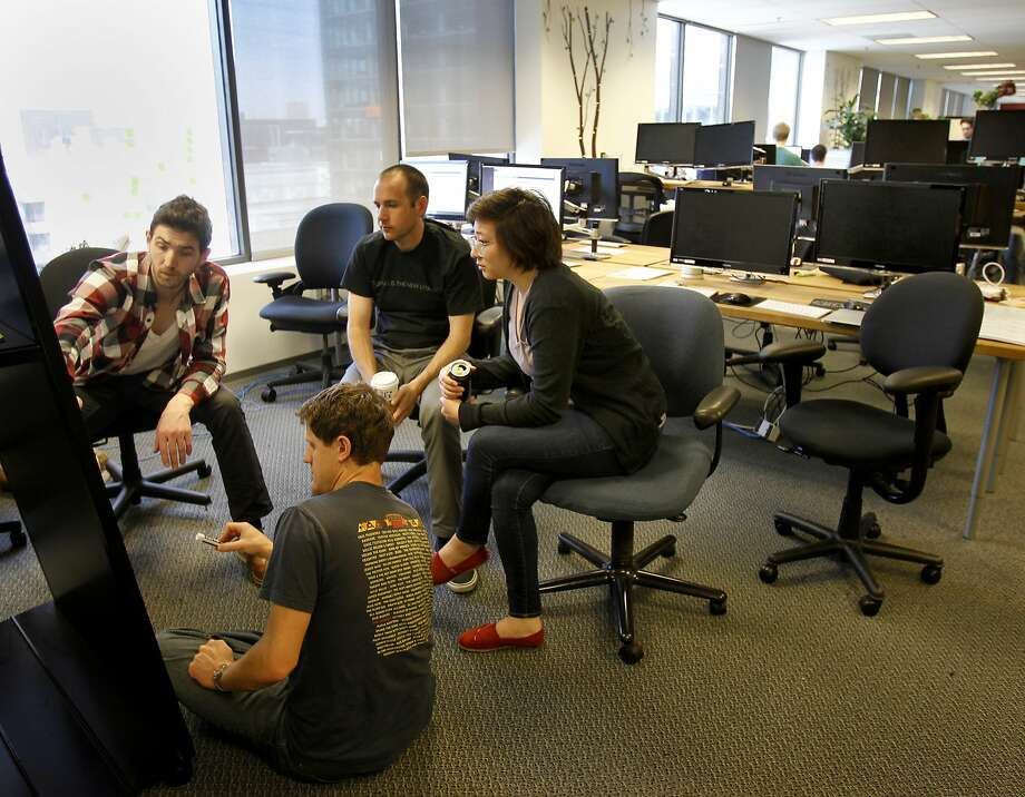 A group of students in San Francisco works on a database for surveys at Dev Bootcamp, a hands-on, nine-week intensive school for computer programming. Photo: Brant Ward, The Chronicle