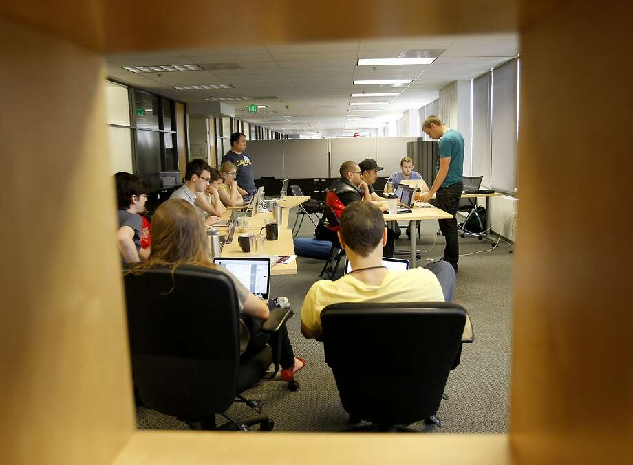 Companies with an Internet presence are hiring computer programers to  create code for their products and apps. In some cases, there's a team  of coders who work together.  Photo: Brant Ward, The Chronicle