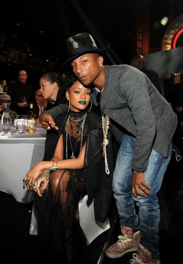 Recording artists Rihanna (L) and Pharrell Williams in the audience at the 2014 iHeartRadio Music Awards held at The Shrine Auditorium on May 1, 2014 in Los Angeles, California. Photo: Kevin Mazur, Getty Images For Clear Channel