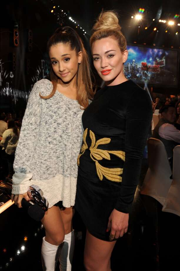 Singer Ariana Grande (L) and actress Hilary Duff in the audience at the 2014 iHeartRadio Music Awards held at The Shrine Auditorium on May 1, 2014 in Los Angeles, California. Photo: Kevin Mazur, Getty Images For Clear Channel