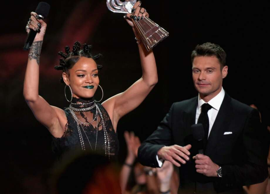 Recording Artist Rihanna accepts the award for Artist of the Year from  Ryan Seacrest onstage during the iHeartRadio Music Awards held at the Shrine Auditorium on May 1, 2014. Photo: Mark Davis/NBC, NBCU Photo Bank Via Getty Images