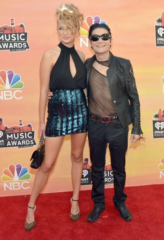Model Courtney Anne and actor Corey Feldman arrive at the iHeartRadio Music Awards held at the Shrine Auditorium on May 1, 2014. Photo: Michael Buckner/NBC, NBCU Photo Bank Via Getty Images