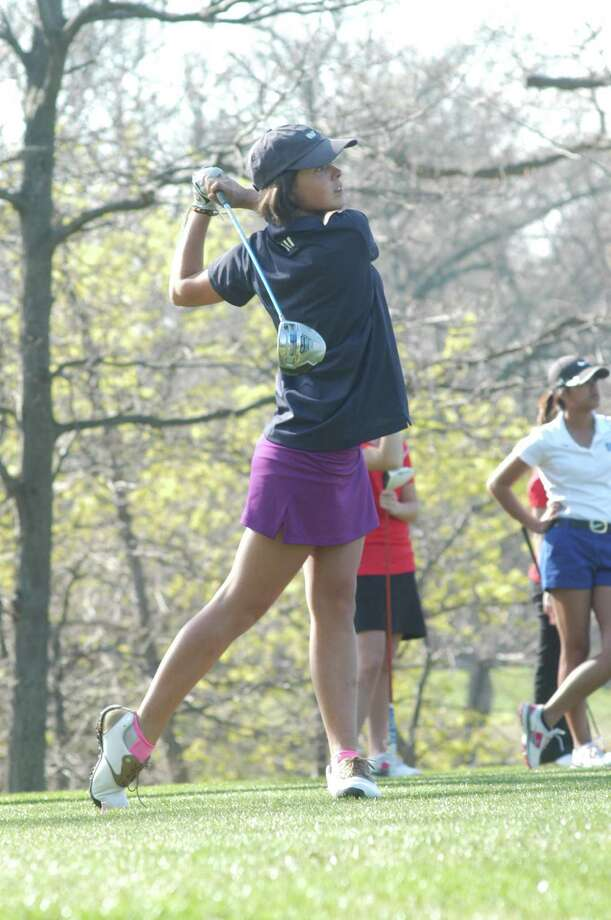 Staples Marie McHugh takes a swing during golf showdown between Greenwich and Staples on Thursday, May 1 2014. Photo: Andy Hutchison/For The Westport / Westport News Contributed