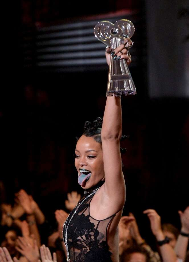 Singer Rihanna accepts the Artist of the Year award onstage during the 2014 iHeartRadio Music Awards held at The Shrine Auditorium on May 1, 2014 in Los Angeles, California. Photo: Kevin Winter, Getty Images For Clear Channel