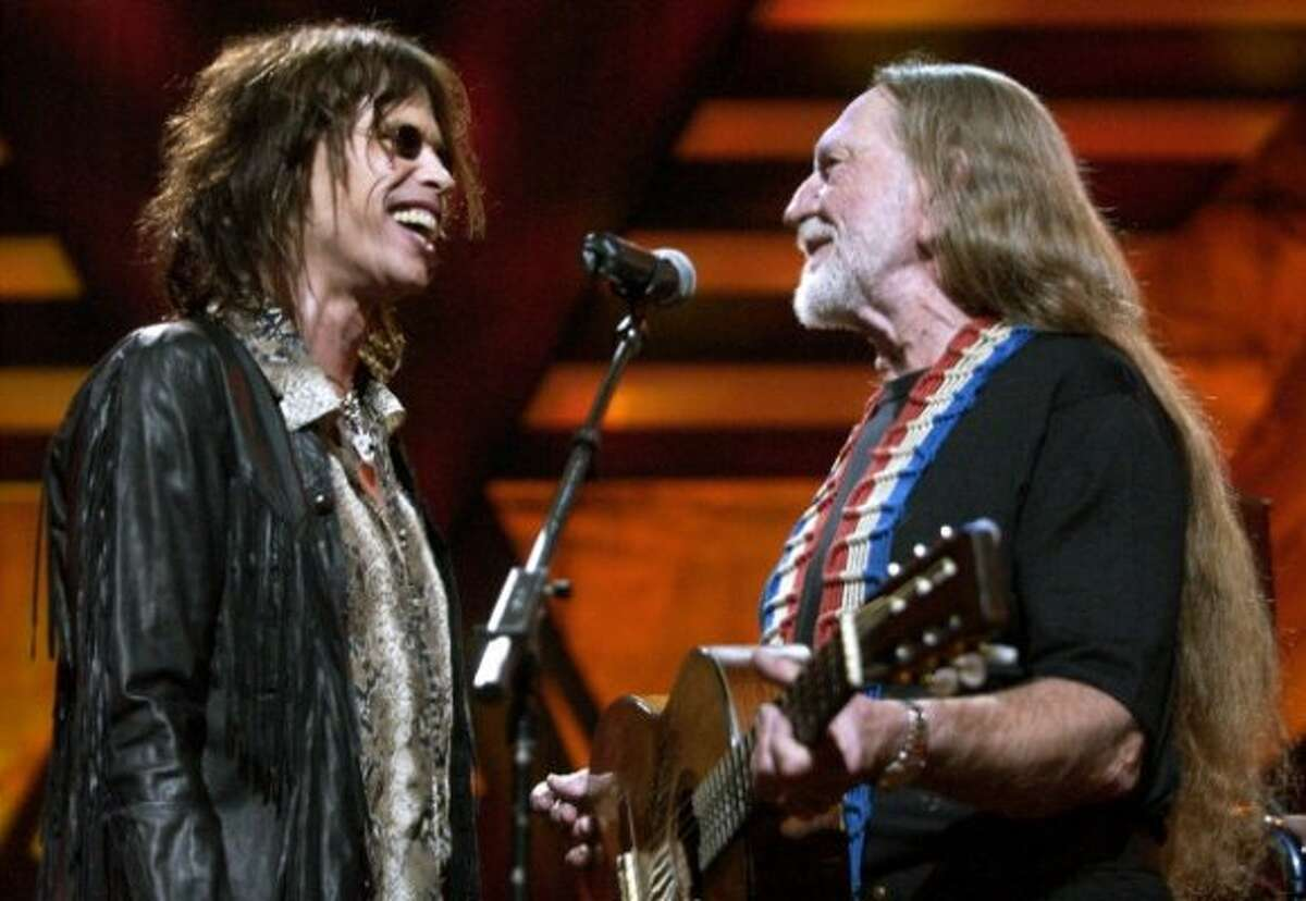Steven Tyler and Willie Nelson performing during