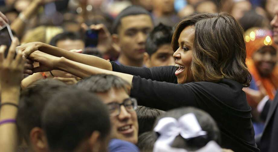 First Lady Michelle Obama reaches out to high school students at Destination College: 4th Annual College Signing Day at The University of Texas at San Antonio's Convocation Center, Friday, May 2, 2014. Photo: Bob Owen, San Antonio Express-News / ©2013 San Antonio Express-News