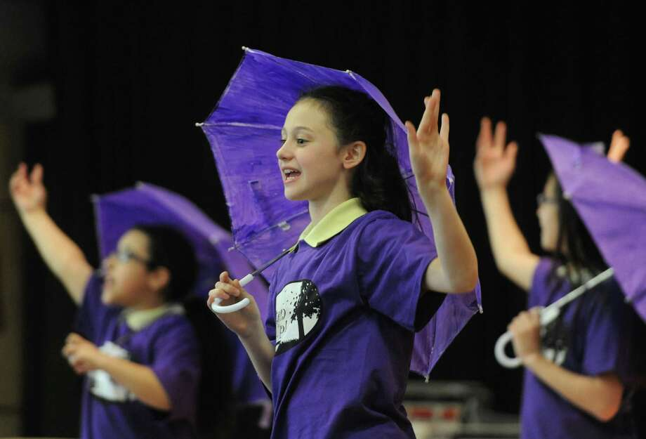 "Fifth-grader Remy Chila performs a selection from St. Joseph School's spring musical during the visit of Frank J. Caggiano, Bishop of the Roman Catholic Diocese of Bridgeport, at the school in Danbury, Conn. Friday, May 2, 2014.  Bishop Caggiano visited different schools within Fairfield County, including Saint Mary School in Ridgefield, to meet with teachers and students and get to know the schools better.  Children at St. Joseph School gave Bishop Caggiano a preview of their upcoming musical ""Listen Up!"" which will be performed May 16 through May 18 at the school. Photo: Tyler Sizemore / The News-Times"