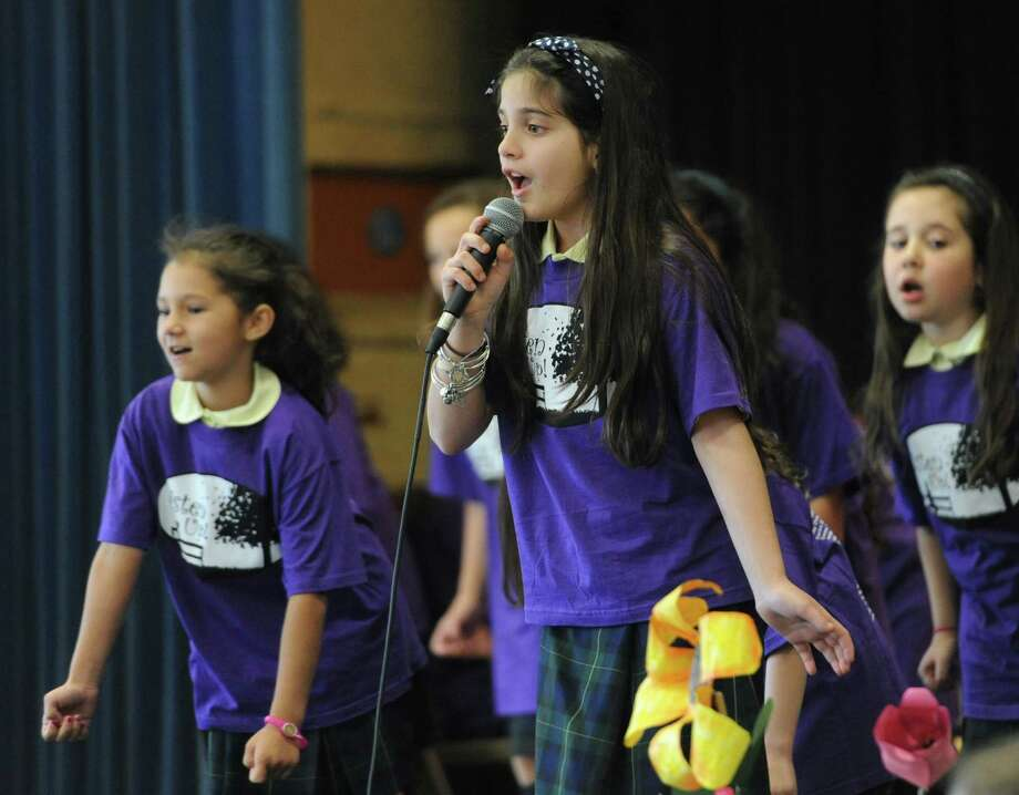 "Fifth-grader Julia Buzzi sings a selection from St. Joseph School's spring musical during the visit of Frank J. Caggiano, Bishop of the Roman Catholic Diocese of Bridgeport, at the school in Danbury, Conn. Friday, May 2, 2014.  Bishop Caggiano visited different schools within Fairfield County, including Saint Mary School in Ridgefield, to meet with teachers and students and get to know the schools better.  Children at St. Joseph School gave Bishop Caggiano a preview of their upcoming musical ""Listen Up!"" which will be performed May 16 through May 18 at the school. Photo: Tyler Sizemore / The News-Times"