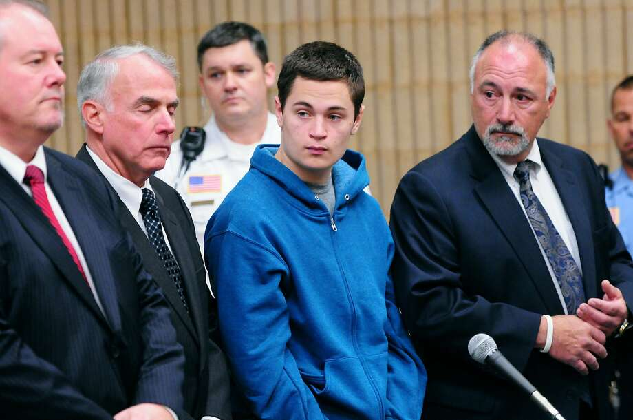 Christopher Plaskon, 16, second from right, stands with defense attorneys Edward Gavin, left, and Richard T Meehan, Jr., far right, and appointed guardian and uncle Paul Healy, second from left, during his public court appearance at Superior Court Friday, May 2, 2014, in Milford, Conn. He is charged in the fatal stabbing of Maren Sanchez, 16, who was stabbed to death on April 25 inside a hallway at Jonathan Law High School in Milford. (AP Photo/New Haven Register, Peter Hvizdak, Pool) Photo: Peter Hvizdak, Associated Press