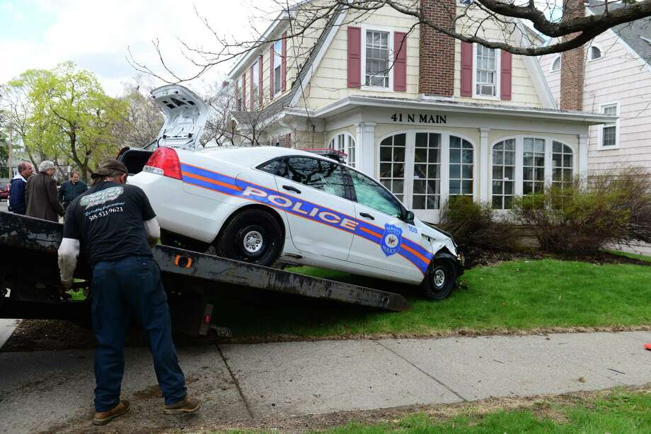 An Albany police officer and another person were taken to the hospital after a wreck Friday, May 2, 2014, on North Main Avenue that sent a police car crashing into a home and another vehicle into a utility pole on Friday. (Will Waldron / Times Union) Photo: WW