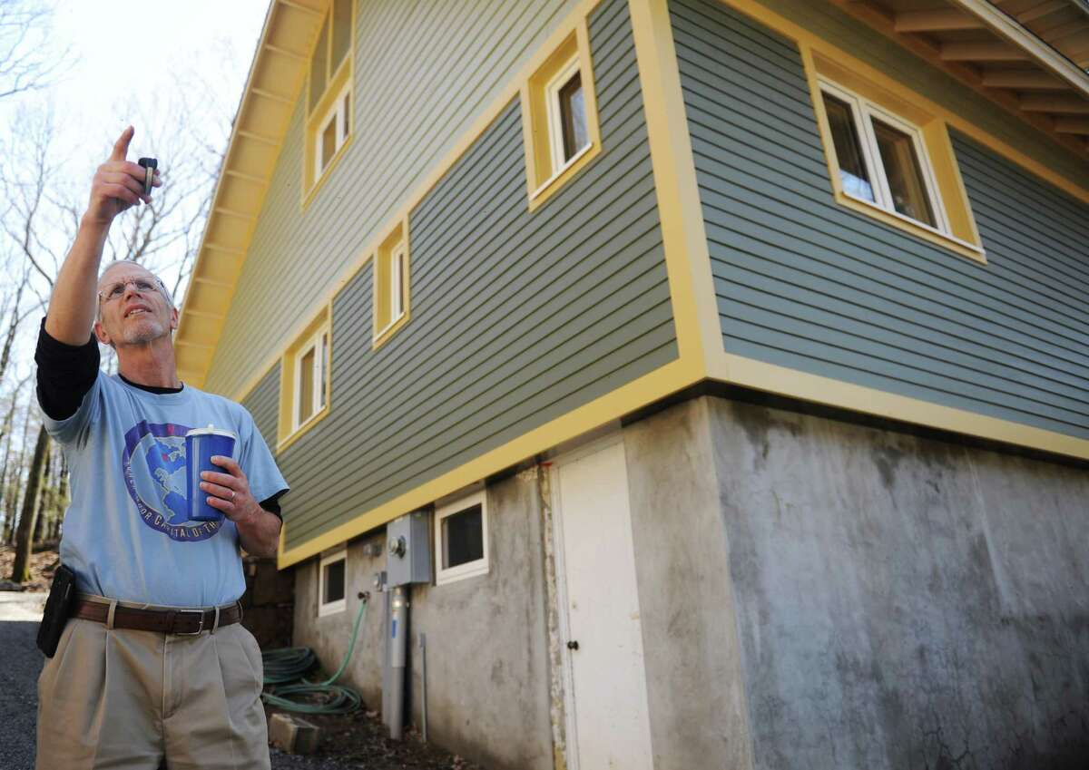 Local builder and home owner Mike Troelle shows off his energy-efficient home near Waubeeka Lake in Danbury, Conn. Thursday, May 1, 2014. Troelle is one of the winners of Connecticut's Zero Energy Challenge for modifications he made to his home during a major renovation project.