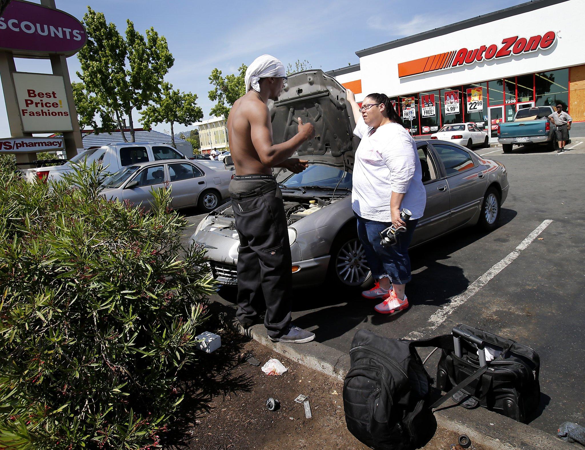 entrepreneur auto mechanics set up discount repair shop in retail parts store parking lot