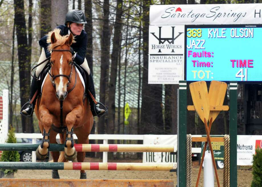 Kyle Olson rides her horse Jazz in the 2014 Saratoga Springs Horse Show Friday, May 2, 2014, on the Saratoga Race Course grounds in Saratoga Springs, N.Y. (Michael P. Farrell/Times Union) Photo: Michael P. Farrell / 00026724A