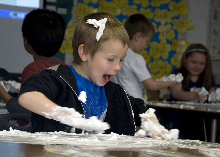 Math has sure changed since we were in school:Kindergartner Andrew Detro plays with a 