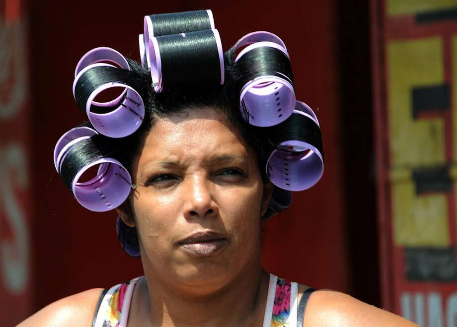Hi, Mom! A head full of hot rollers makes a public appearance in Panama City, Panama. Photo: Orlando Sierra, AFP/Getty Images