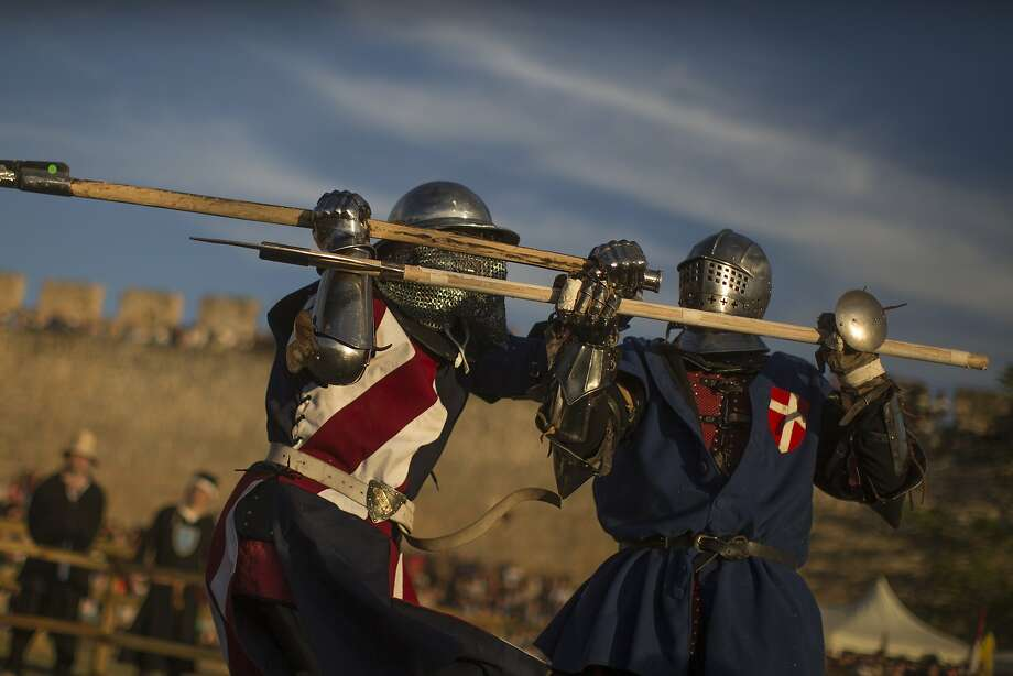 "Ye shall regret calling me an anachronism, insolent knave!""Knights"" from the United States (left) and Denmark duel during the Medieval Combat World Championship tournament in Belmonte, 
